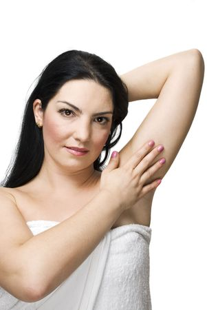 armpits: Brunette woman touching her armpit and showing a health skin isolated on white background