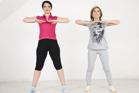 Two women young and old  doing fitness and training exercises photo
