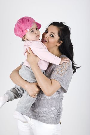 Happy mother holding her baby girl and smiling Stock Photo - 6836959