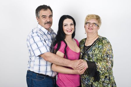Three members of family father,daughter and mother embracing and smiling in front of image Stock Photo - 6836973