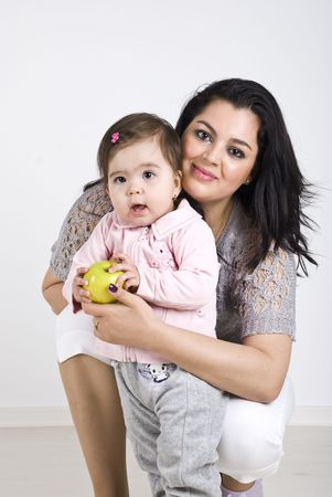 Happy mother and her baby girl 11 months old posing together photo