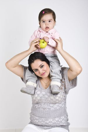 Young mother holding baby girl on her shoulders  photo