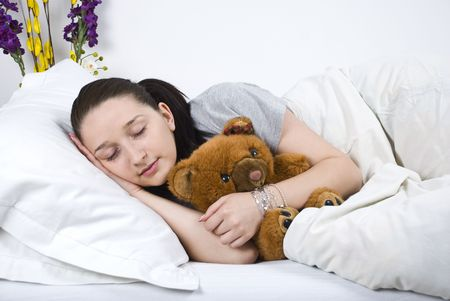 nightclothes: Beauty woman sleeping and hugging her teddy bear Stock Photo