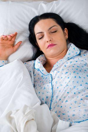 Beautiful brunette woman sleep in her bed Stock Photo - 6960499