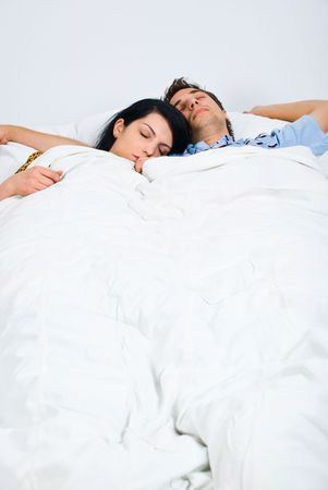 Young couple sleeping on bed  ,woman rest her head on his shoulder photo