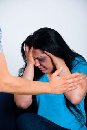 Afraid abused woman being scared by her husband photo
