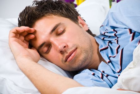 nightclothes: Portrait of young man sleeping in his bed Stock Photo