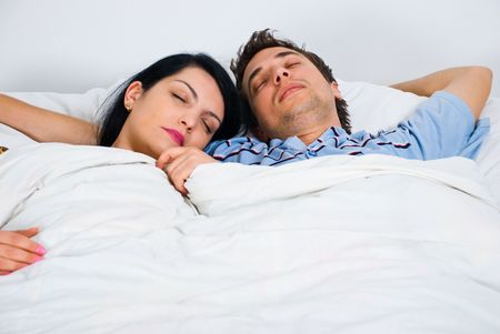 Portrait of young couple on bed sleeping together Stock Photo - 6960526