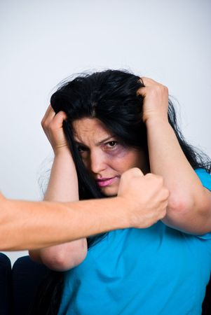 beaten woman: Injured woman  being scared about  man fist Stock Photo