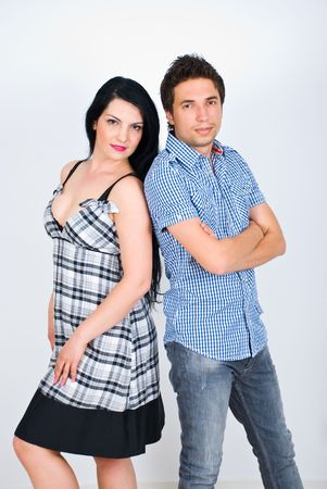 Beautiful young couple posing back to back in a fashionable style Stock Photo - 6960578