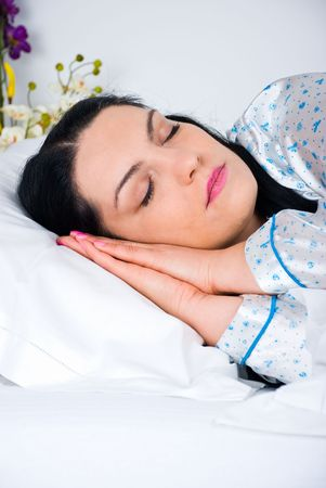 Close up of beauty woman sleeping with hands under face in her bed Stock Photo - 6960585