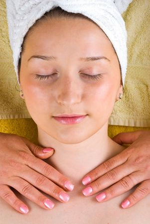 Young woman receiving a neck massage at spa salon photo