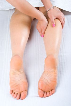 Close up of woman getting legs massage at spa center photo