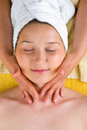 Beautiful female receiving a  soft neck massage from a beautician at spa salon photo
