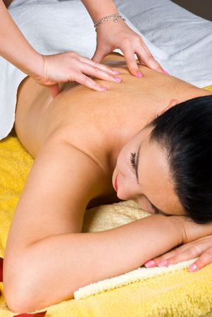 Young woman getting back massage at spa resort photo