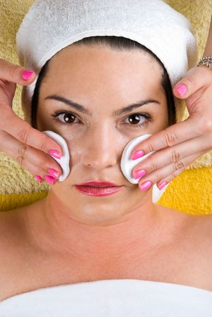 Young woman getting cleasing face at spa Stock Photo - 7125391
