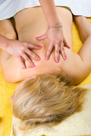 Top view of senior woman getting a back massage at spa  photo