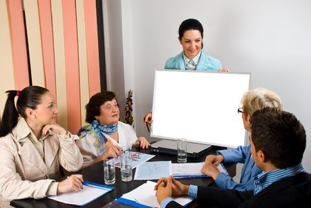 Business group of people having a meeting and a woman making a presentation  with speech on blank board,copy space for text message on placard photo