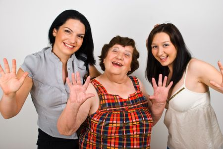 Happy grandmother with granddaughters laughing together and waving hands in front of camera Stock Photo - 7157587