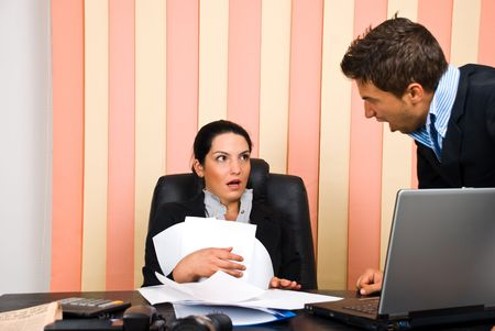 shout: Angry boss screaming to his employer woman and she is surprised and shocked Stock Photo