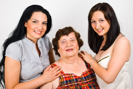 Portrait of smiling grandmother with her two granddaughter  standing together photo