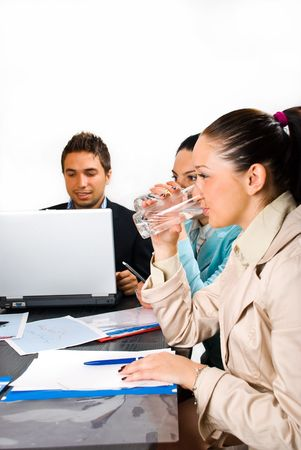 Two business woman drinking water at a meeting  and sitting in  profile photo