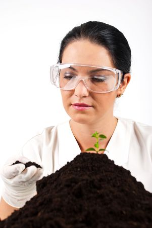 Agricultural scientist woman check soil and smile in a laboratory photo