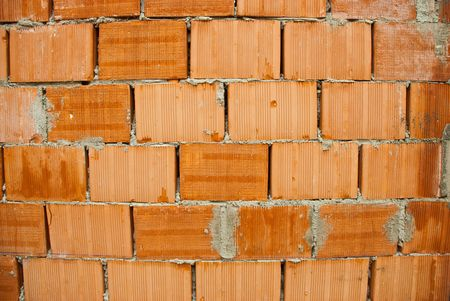 Background of red bricks wall with cement photo