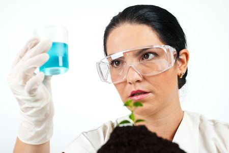 Scientist woman holding a jar with blue chemicals and having a surprised face photo