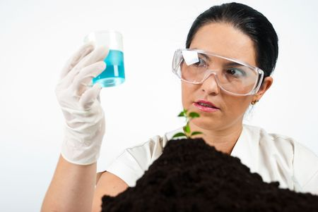 Scientist woman analyze blue liquid in laboratory photo