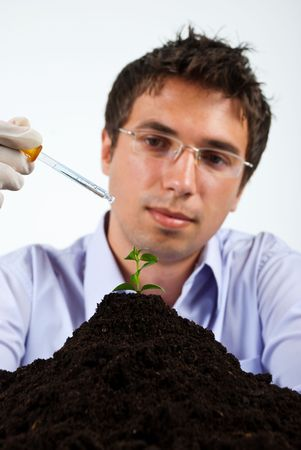 Researcher man working in laboratory,selective focus on plant photo