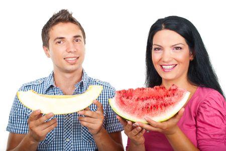 Healthy couple smiling and holding slices of watermelon and melon isolated on white background Stock Photo - 7564746