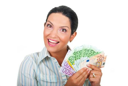 Happy woman holding money  in her hands and looks amazed isolated on white background photo