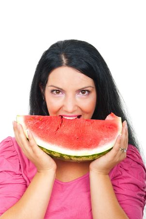 Beautiful brunette woman eating a slice of watermelon and smiling isolated on white background photo