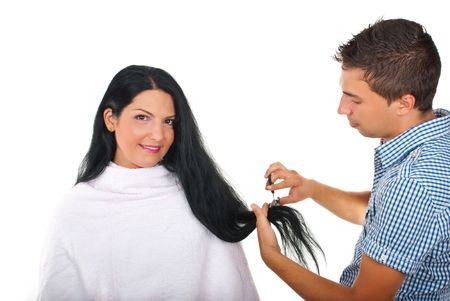 Hairstylist cutting long brunette woman hair in a beauty salon photo