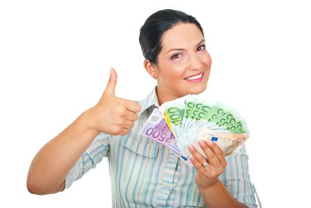 Excited woman with handful of money giving thumbs up isolated on white background photo