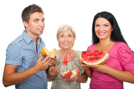 Healthy family holding watermelon,melon or  melons salad and smiling isolated on white background photo