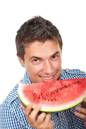 Young man holding a slice of water melon isolated on white background photo