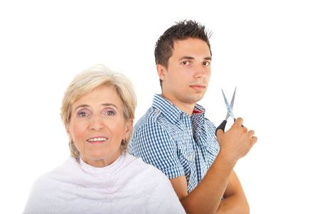 Hairstylist man holding scissors and   preparing to cutting hair to a beautiful senior woman isolated on white background,copy space for text message photo