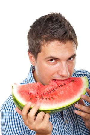 Portrait of young man biting a slice of water melon isolated on white background photo