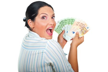 looking over shoulder: Excited winner woman holding a lot of money and looking over shoulder with a suprised  face isolated on white background