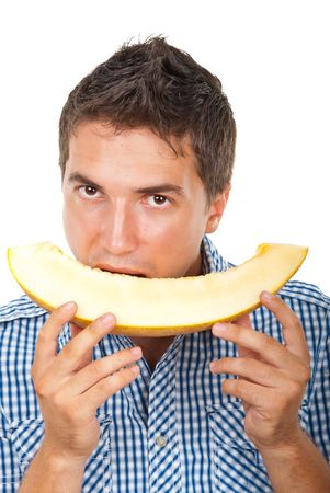 Young man eating a slice of cantaloupe isolated on white background Stock Photo - 7590100