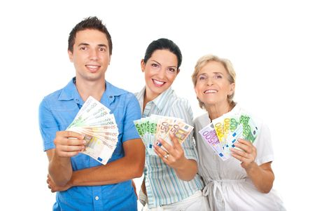 Three happy people in a row holding a lot of money and smiling isolated on white background photo