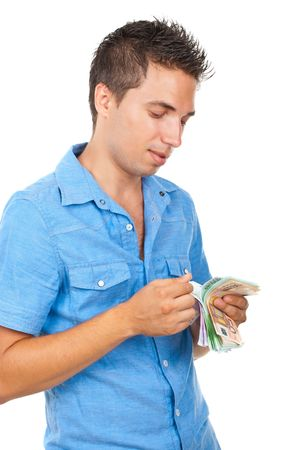 Rich man counts his money and standing in semi profile and smiling isolated on white background photo