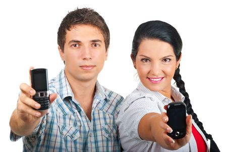 Young couple smiling and showing their phones mobile isolated on white background photo