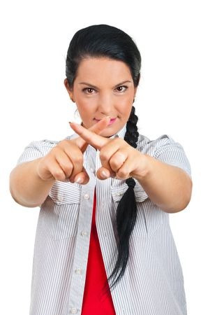 Woman with fingers crossed forming a cross in front of her face  photo