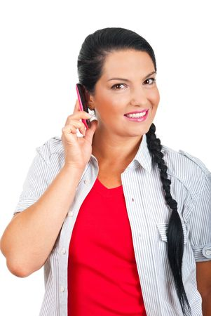 Happy woman talking by cell phone and smiling isolated on white background photo