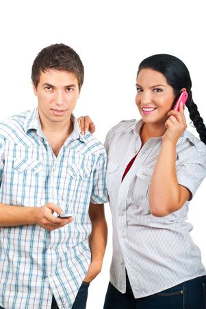 Happy couple using phones mobile,man sending messages and the woman having a funny conversation by  cell phone and laughing isolated on white background photo
