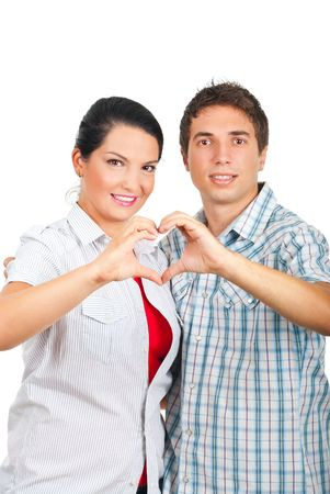 Beautiful lovely couple in love standing  embracing and forming a heart with their hands isolated on white background photo
