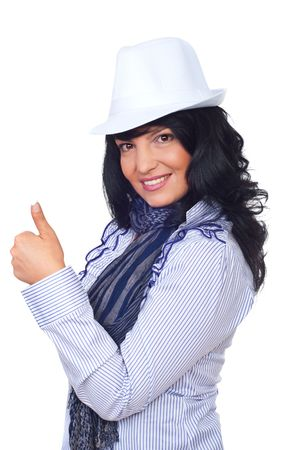 Modern businesswoman wearing hat standing in semi profile and giving thumb up isolated on white background photo
